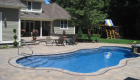 22-Unilock-Beacon-Hill-Flagstone,-copthorn-inlay,-bullnose-pool-coping-and-stone-veneered-spa-(2)