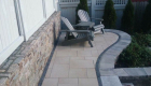 54-Unilock Umbriano pavers with Estate wall. Granite steps, under cap lighting, planting and firepit (6)