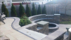 55-Unilock Umbriano pavers with Estate wall. Granite steps, under cap lighting, planting and firepit (7)